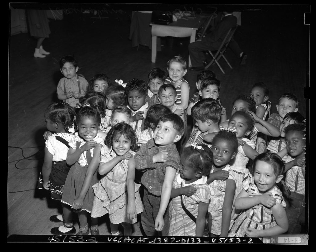 Children receiving small pox vaccinations at Ann Street School in Los Angeles