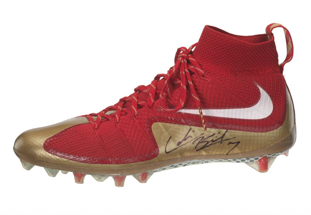 Pair of football cleats signed by Colin Kaepernick