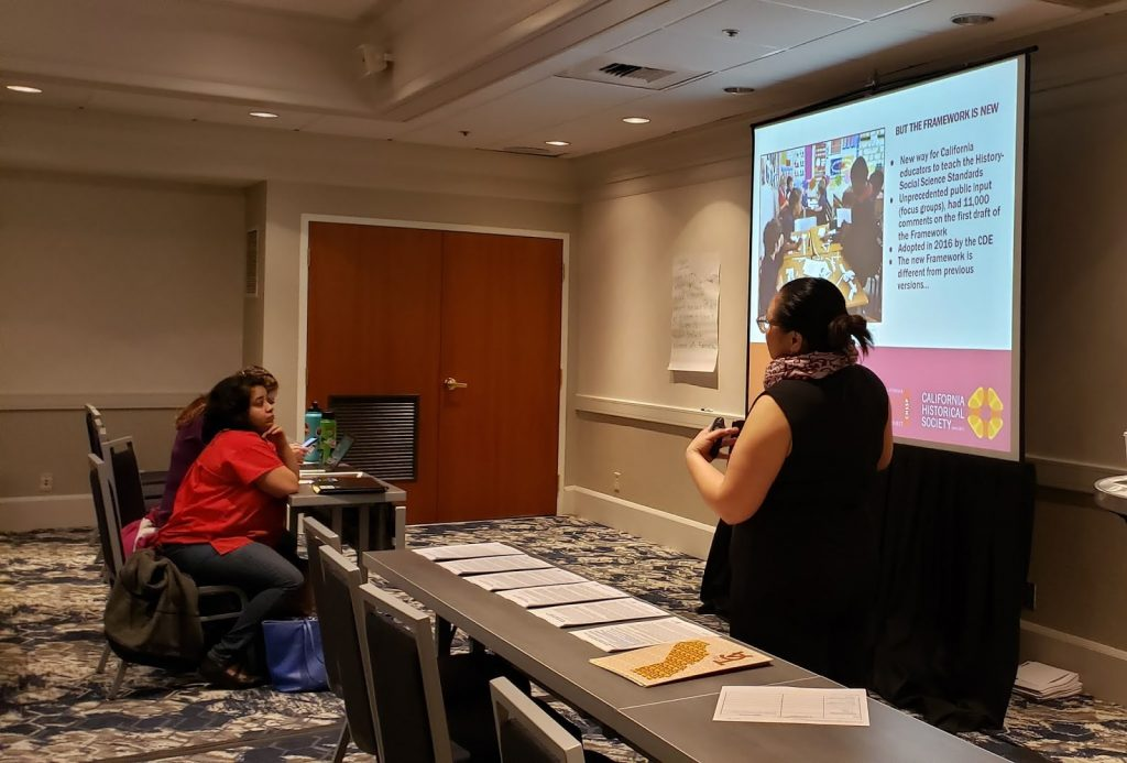 Tuyen Tran, Assistant Director of CHSSP, going over the basics of California's new History-Social Science Framework in a PowerPoint presentation.