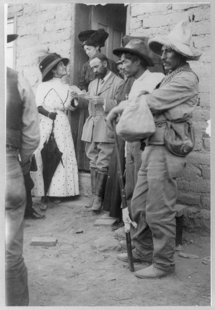 [Mexican insurrection activities: Francisco Madero, with Mrs. Madero and Miss Campa, reading a peace message]