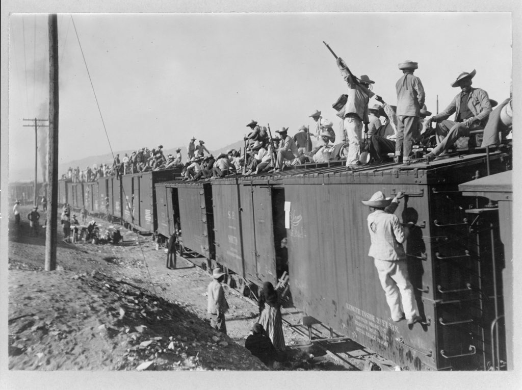 Mexico – Sonora, Yaqui Indians, enlisted in the Mexican Army, being transported by box cars