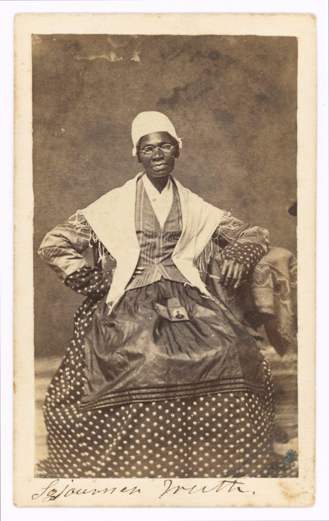 [Sojourner Truth seated with photograph of her grandson, James Caldwell of Co. H, 54th Massachusetts Infantry Regiment, on her lap]