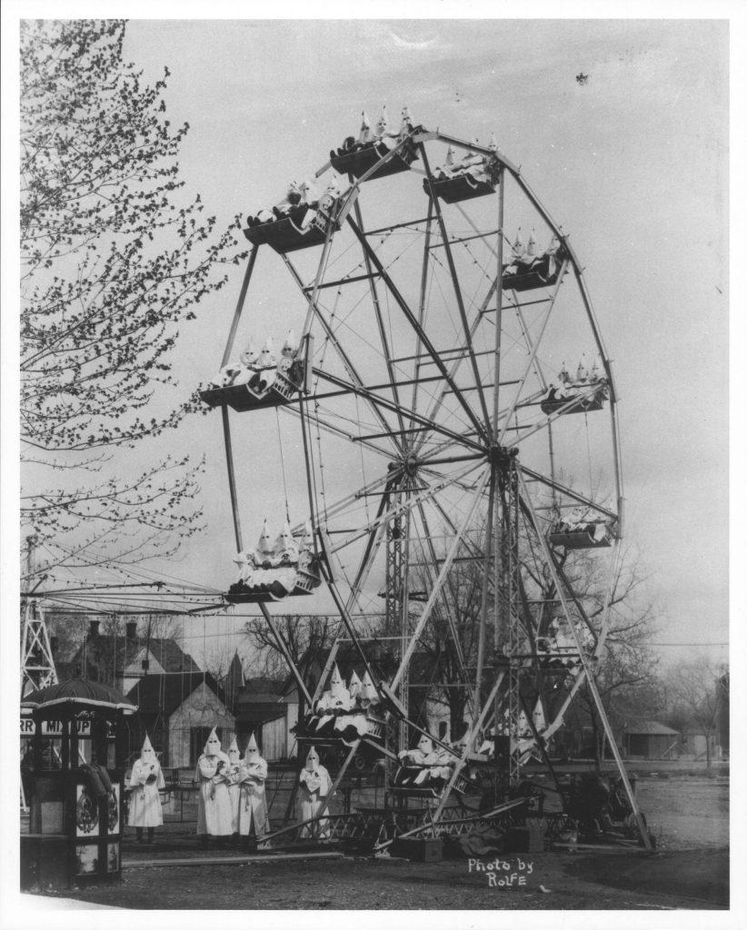 11.5.10a Ku Klux Klan members on ferris wheel