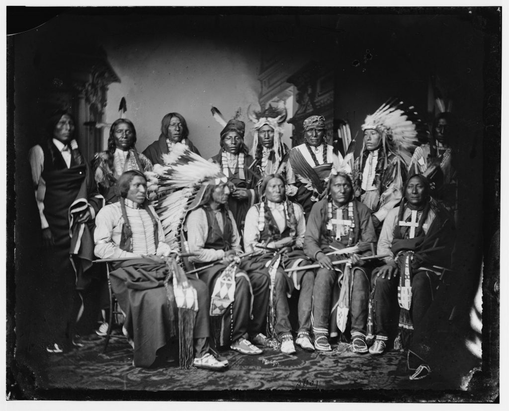 5.1.4 Red Cloud and Indians. Standing: Red Bear (Sons Are?), Young Man Afraid of his Horse, Good Voice, Ring Thunder, Iron Crow, White Tail, Young Spotted Tail; seated: Yellow Bear, Jack Red Cloud, Big Road, Little Wound, Black Crow
