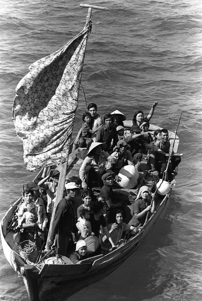 11.9.7 35 Vietnamese refugees wait to be taken aboard the amphibious command ship USS BLUE RIDGE (LCC-19)